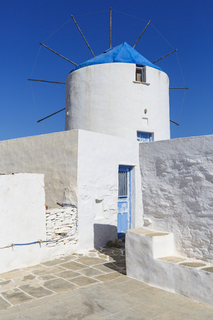 cycladic: Old traditional windmill in Artemonas village on Sifnos island in Greece. Stock Photo