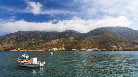 Traditional fishing boats in the harbour of Kamares villge, Sifnos island, Greece.
