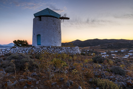 cycladic: Old windmill near Chora village on Kimolos island in Greece.