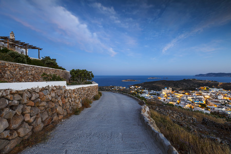cycladic: Chora village on Kimolos and Milos island in the distance.