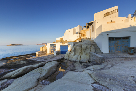 cycladic: Boat houses in fishing village of Goupa on Kimolos island in Greece. Stock Photo