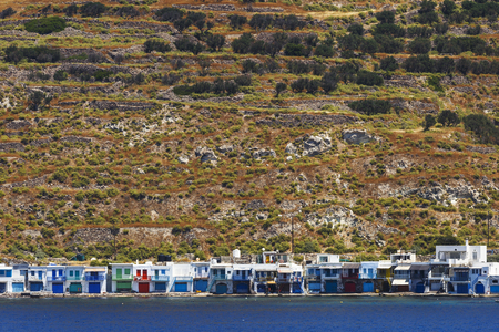 cycladic: Klima village on the coast of Milos island as seen from the ferry.