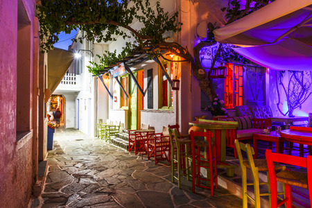 cycladic: Coffee shops and bars in the main street of Chora village on Kythnos island in Greece. Editorial