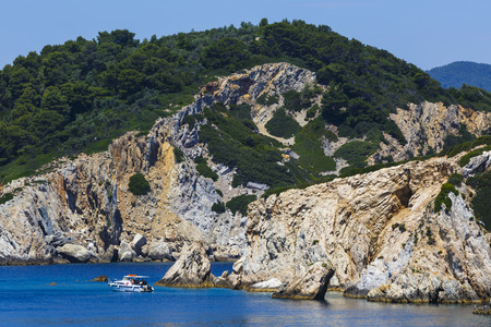 Boat of a diving center at Repi and Arkos islets near Skiathos island, Greece.