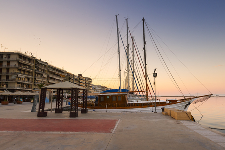 boas: Sail boats in the harbour of Volos city as seen early in the morning.