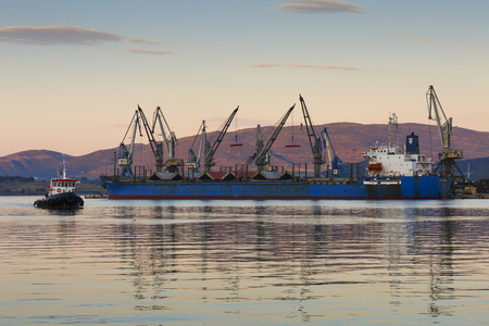 Cargo ship in the port of Volos city as seen early in the morning.