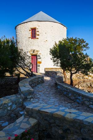 Rebuilt traditional windmills on a hill above Panteli village on Leros island, Greece.