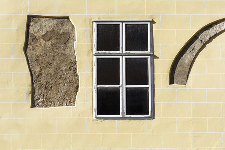 Wall and a window of an old building in the old town of Buda in Budapest.