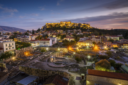 View of Acropolis from a roof top coctail bar at sunset, Greece. 免版税图像