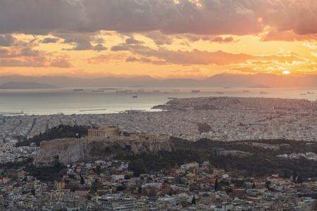 View of Acropolis and city of Athens from Lycabettus hill at sunset, Greece.