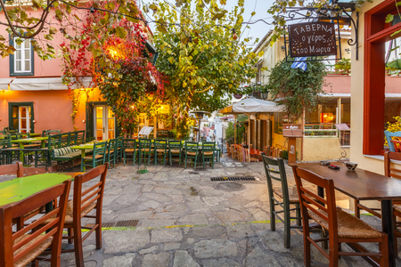 Coffee shops in streets of Plaka, the old town of Athens, Greece.