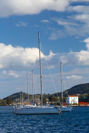 Boats anchored in the harbor of Poros island in Greece. Redakční