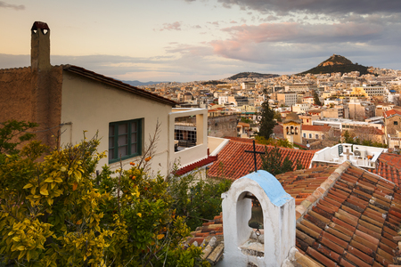 View of Lycabettus hill from Anafiotika neighborhood in the old town of Athens, Greece. Banco de Imagens