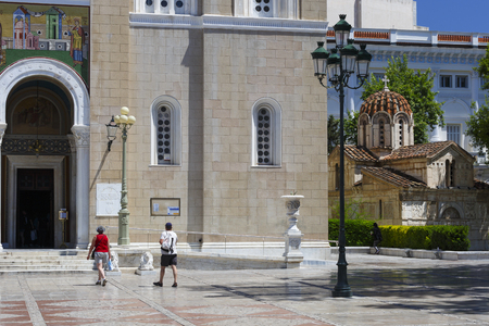 Athens, Greece - May 14, 2018: Small historical church next to Athenian cathedral which is frequently overlooked  by tourists who visit the square because of the large and impressive cathedral.
