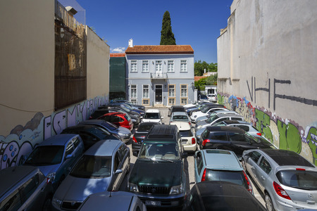 Athens, Greece - May 14, 2018: Car parks like this can be found in the central parts of Athens and they might easily leave people wondering about how one gets in or out. 報道画像