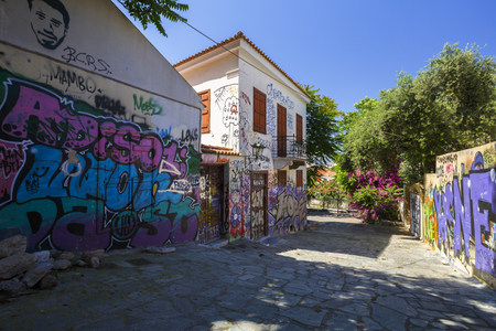 Athens, Greece - May 14, 2018: Plaka, the old town of Athens, is known for its ancient sites and charming neoclassical buildings however it has its other side as well.