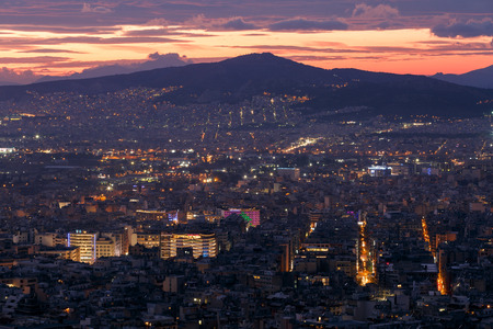 Athens, Greece - December 8, 2018: View of Athens from Lycabettus hill at sunset, Greece. Редакционное