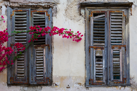 Windows of an old abandoned building in the old town of Athens, Greece. 写真素材