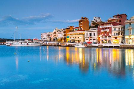 Agios Nikolaos, Greece - April 17, 2017: Evening view of Agios Nikolaos and its harbor, Crete, Greece.