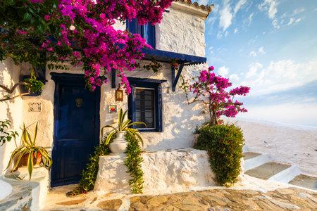 Skopelos, Greece - June 15, 2017: Facade of an old building in Skopelos town, Greece.