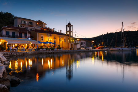 Vathy, Greece - October 3, 2017: Evening view of the church in Vathy harbur on Meganisi island, Greece.