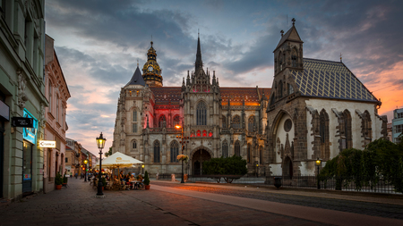 Kosice, Slovakia - August 11, 2018: St. Michael chapel and St. Elisabeth cathedral in the main square of Kosice city in eastern Slovakia. Редакционное
