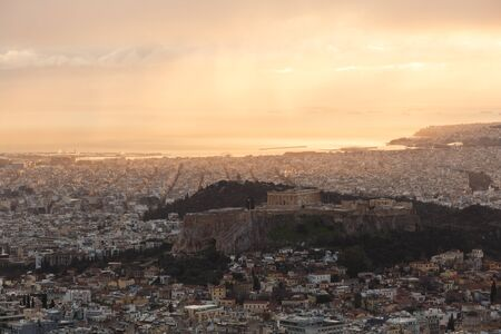 View of Acropolis and Athens from Lycabettus hill at sunset, Greece.
