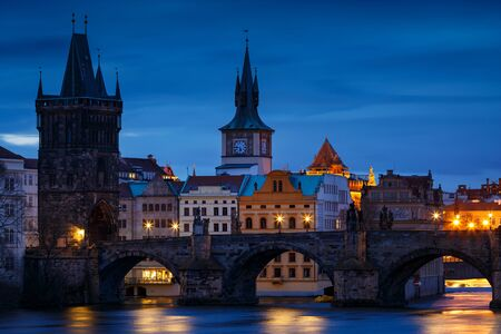 Morning view of Charles Bridge and Old Town Bridge Tower over river Vltava.