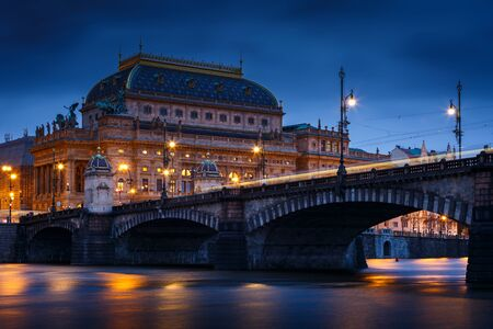 Evening view of the Legions Bridge and National Theatre in Prague from Strelecky island.