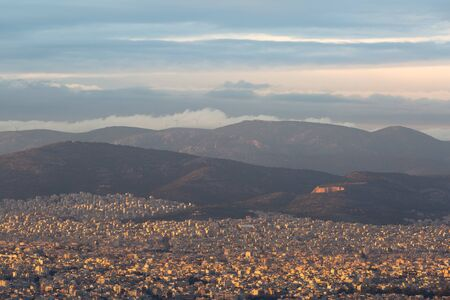 View of Athens and Aigaleo mountain from Lycabettus hill at sunset, Greece.