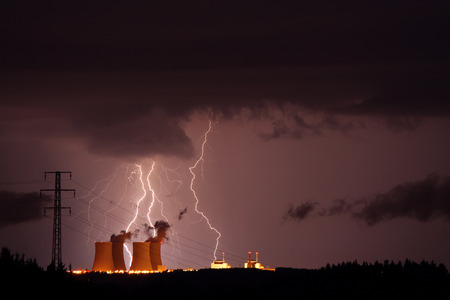 Lightning over nuclear power plant photo