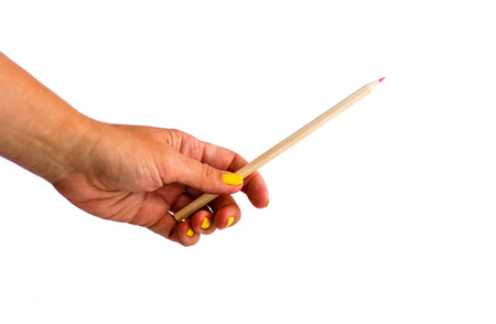 Woman`s hand holding pink pencil photo