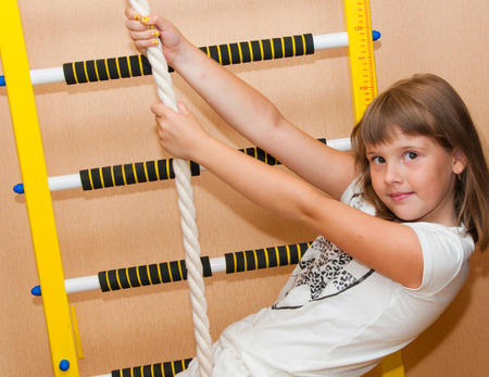 Teen girl near sport ladder at home sport complex photo
