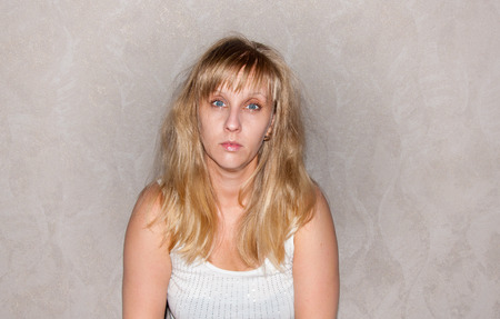 Sad and tired woman with blond hair photo