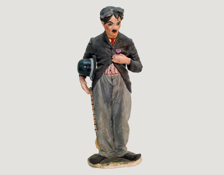 Old statuette of Charlie Chaplin with a stick in his hands