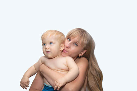 Young blond woman and child smiles - mother and son photo