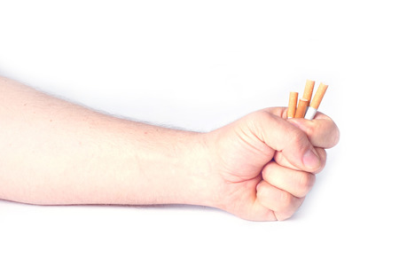 clamped: The mans hand clamped hard a cigarette isolated white.