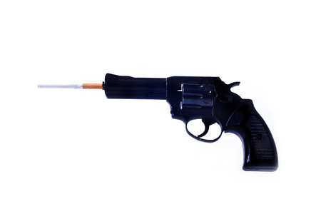 killing cancer: The cigarette is inserted into the barrel of a gun. Isolated white