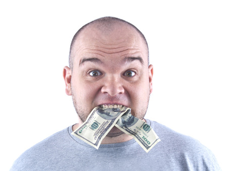 Mad man eats dollar bills portrait isolated white