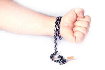 rid: Get rid of addiction seriously. The cigarette is attached to a male hand via a chain on a white background