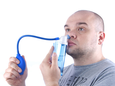 snot: Bald young man washes his nose, common cold treatment at home, isolated white Stock Photo