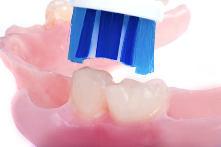 fix jaw: Toothbrush blue cleans dentures tooth