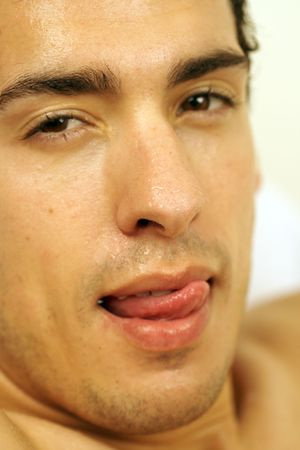 wet lips: a hansome young man with his tounge licking his lips