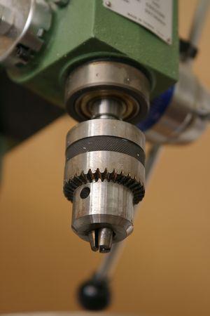 medium close up: A medium close up of a drill head on a work bench