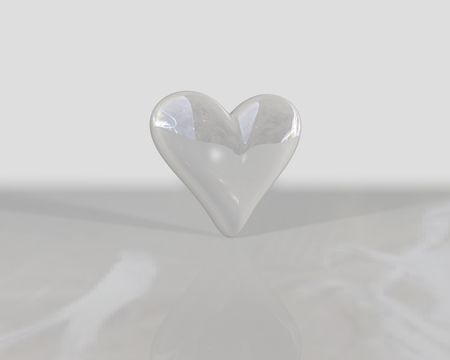 seduction: a heart shaped pearl rendered on a white background Stock Photo
