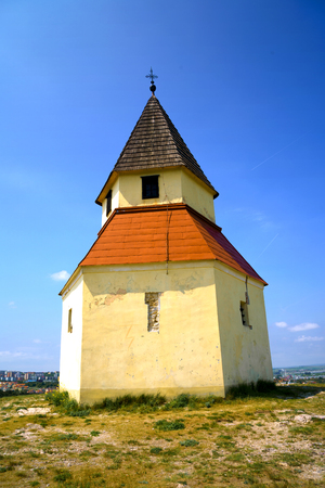 Historic christian chapel on a hill in a sunny day.