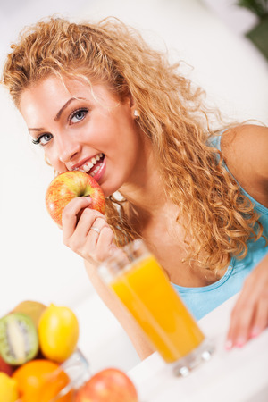 Beautiful young woman with fruits photo
