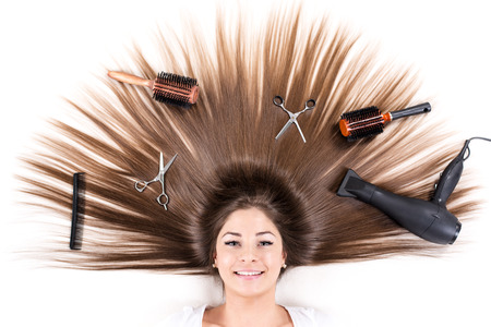 haircutting: Cute young girl with Beautiful healthy shiny hair and Haircutting Equipment