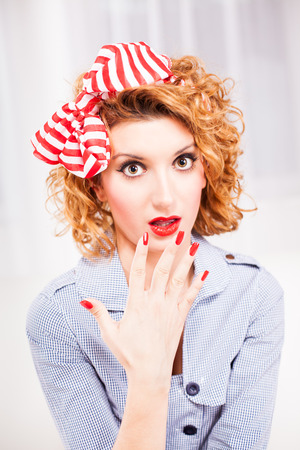 Portrait of surprised retro style woman housewife  photo
