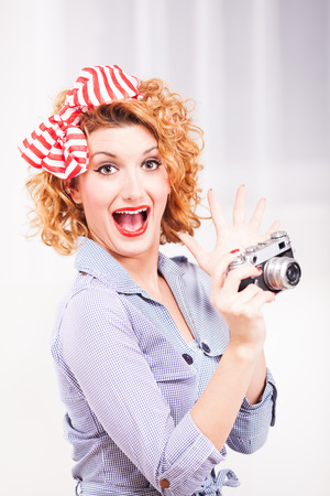 Portrait of elegant retro style woman housewife with photo camera  photo